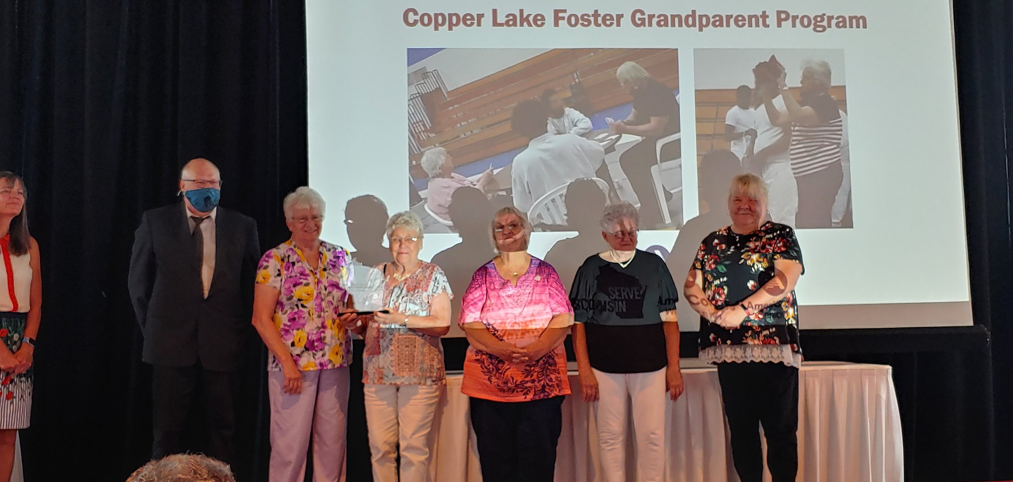 Volunteers in the LHS/CLS Foster Grandparents Program accept their 2021 Governor's Service Award